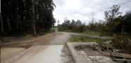 Acceso sin asfaltar a la calle Sionlla de Arriba